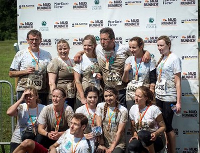 Bankers get muddy to raise thousands for hospice